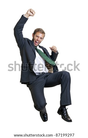 Happy businessman jumping isolated in white
