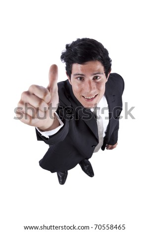 Happy businessman looking up and gesturing ok