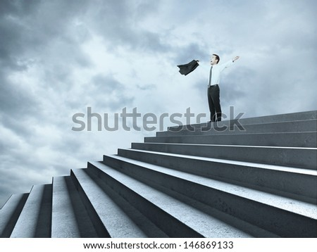 happy businessman near ladder in sky