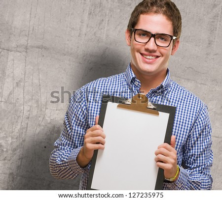 Happy Businessman Showing Paper On Clipboard against a grunge background