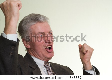 happy businessman smiling and waving his arms