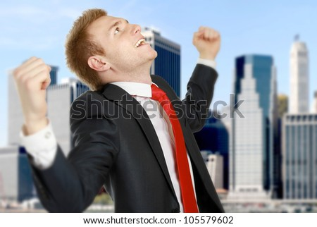 Happy businessman standing  over a cityscape