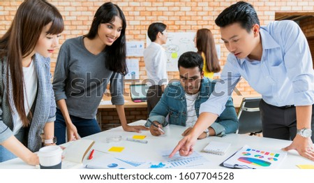 Happy businessman teamwork brainstorm and discussing on white table during business presentation in the office.