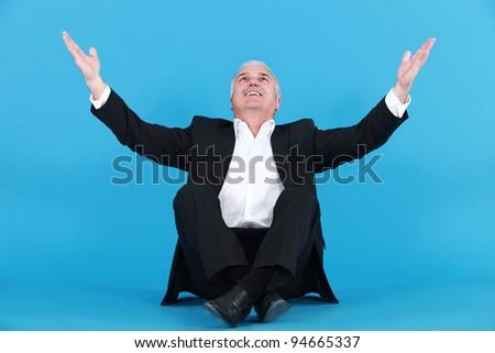 happy businessman thanking God