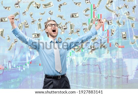 happy businessman trader winner, in cash rain of dollars notes, on diagram background. Trading, fortune, winning, win, concept Stock photo ©