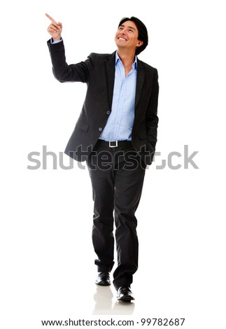 Happy businessman walking and pointing - isolated over a white background