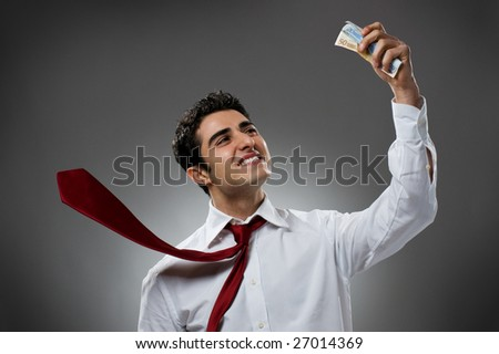 Happy businessman with bundle of euro money, good business! - stock photo