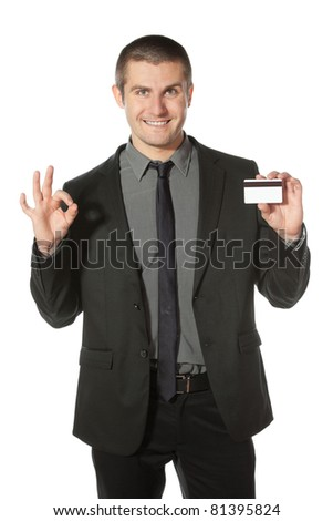 Happy businessman with credit card showing OK sign, isolated on white background