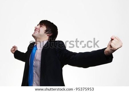 happy businessman with his arms out wide looking up very pleased with himself