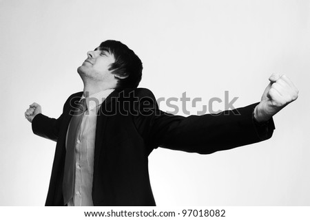 happy businessman with his arms up looking very pleased with himself