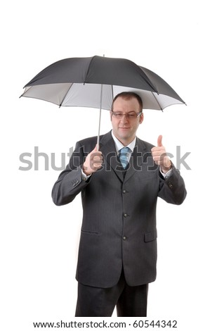 Happy businessman with umbrella giving thumbs up sign