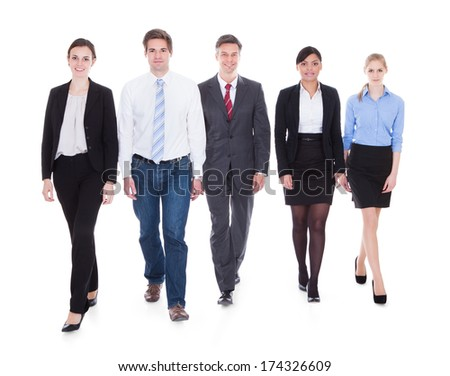 Happy Businesspeople In Group Walking Over White Background