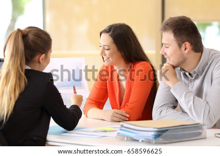 Happy businesspeople talking about earnings during an audit at office