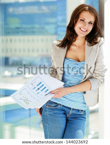 Happy businesswoman holding a paper.