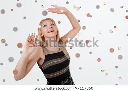 Happy businesswoman in the rain of money - stock photo