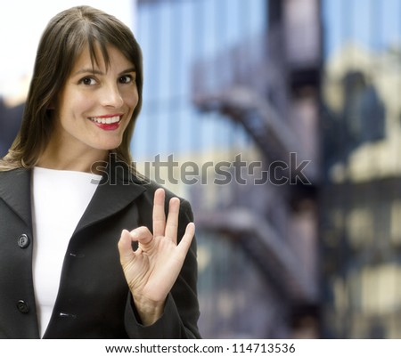 happy businesswoman over office  building background