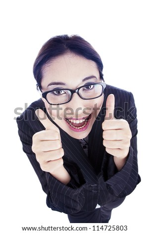 Happy businesswoman showing her thumbs up with big smile