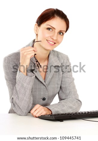 Happy businesswoman sitting on the desk. Isolated on white background.