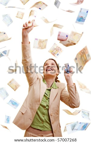 Happy businesswoman standing in a rain of Euro banknotes