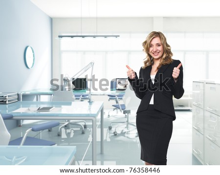 happy businesswoman thumbs up in modern office