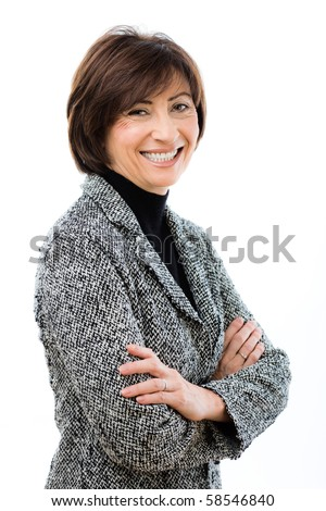 Happy businesswoman wearing grey suit standing with crossed arms, laughing. Isolated on white background.