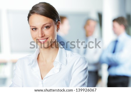 happy businesswoman with...