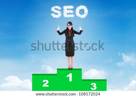 Happy businesswoman with SEO strategy standing on podium