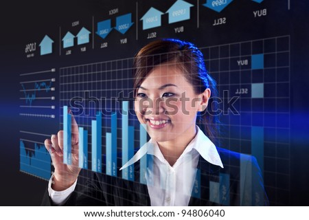 Happy Businesswoman working on a virtual digital Touchscreen.
