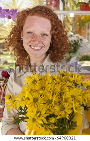 Happy buying flowers in a flower store
