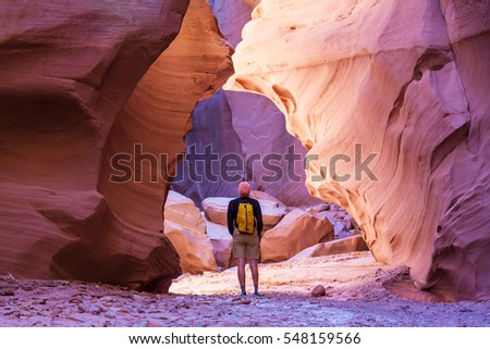 Happy Canyon fantastic scene. Unusual colorful sandstone formations in deserts of Utah are popular destination for hikers.
