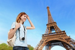 Happy carefree travel woman in Paris with Eiffel Tower, caucasian beauty