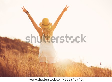 Happy Carefree Young Woman Outdoors. Fashion Lifestyle Portrait. Soft warm sunny colors.