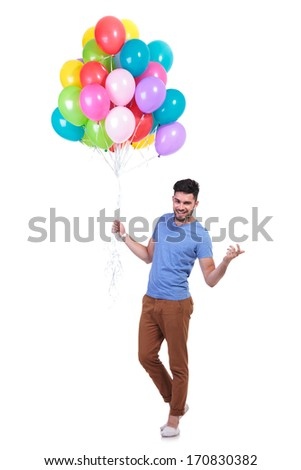 happy casual man holding a...