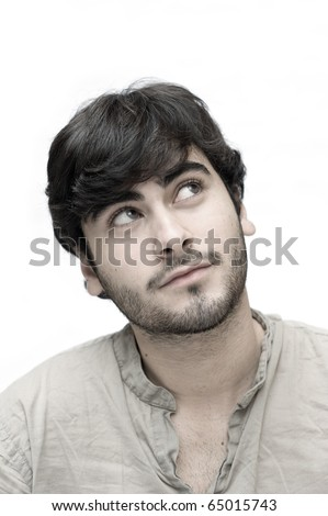 Happy casual man looking up over white background.