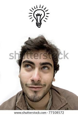 Happy casual man looking up over white background having an idea.