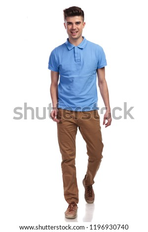 happy casual man walking forward on white background #1196930740