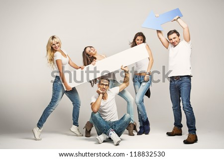 Happy casual people with white empty board - stock photo