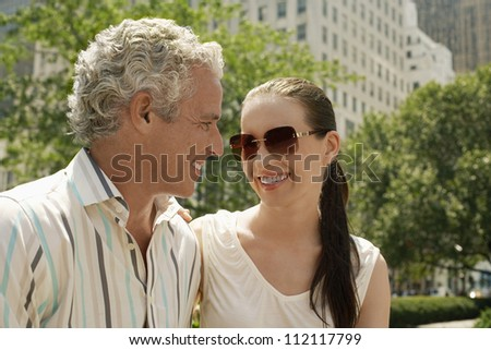 Happy Caucasian couple looking at each other