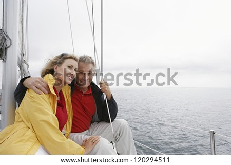 Happy Caucasian couple on vacations in sail boat