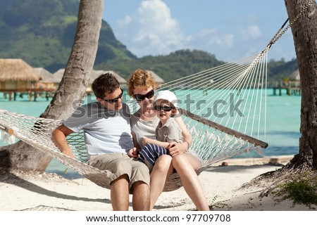 happy caucasian family enjoying time together at the beach