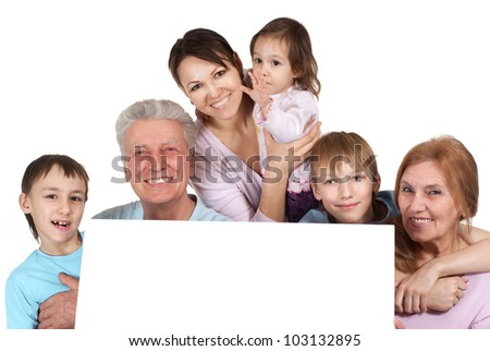Happy Caucasian family of six people holding the paper on a white background