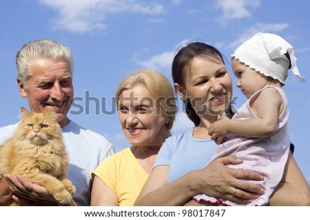 Happy Caucasian happy family of four standing in the street