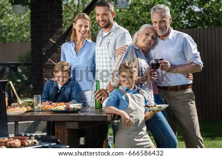 happy caucasian multi-generational family having picnic on patio at daytime