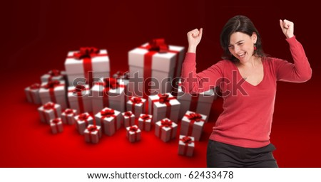 Happy celebrating brunette with lots of gift boxes - stock photo