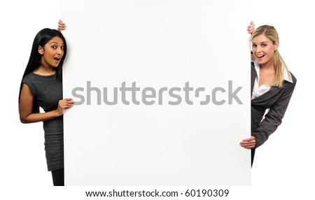 Happy, cheerful business girls hold a presentation board