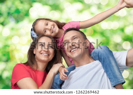 Happy cheerful family on background #1262269462