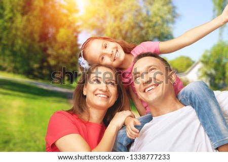 Happy cheerful family on background #1338777233