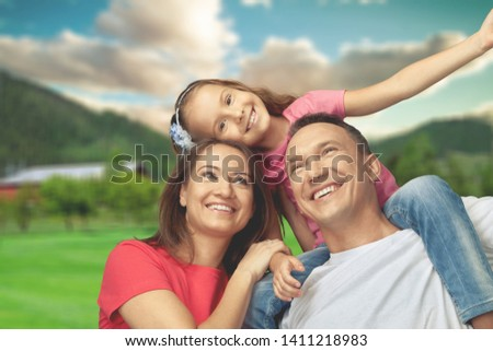 Happy cheerful family on background #1411218983