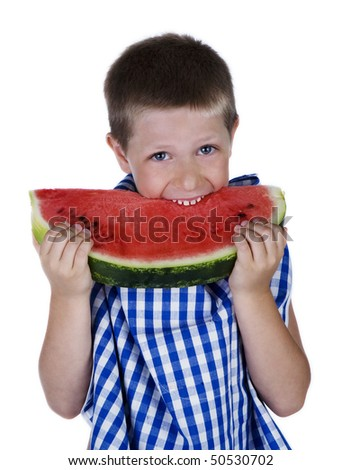Happy child biting a big watermelon slice, studio shot isolated on white background