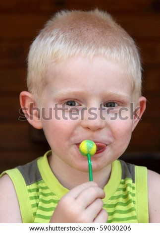 happy child eating a lollipop